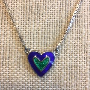 Enameled heart necklace.